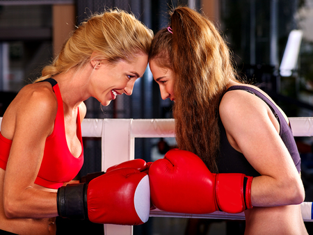 showgirl: Two  friendly women boxer wearing red  gloves to box in ring. Stock Photo