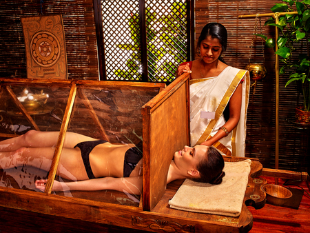 healing plant: Woman having  India exotic sauna treatment. Stock Photo