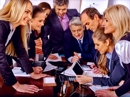 enthusiastically: Happy group business people enthusiastically work in office.