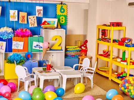 Interior of kids game room with toys in kindergarten.