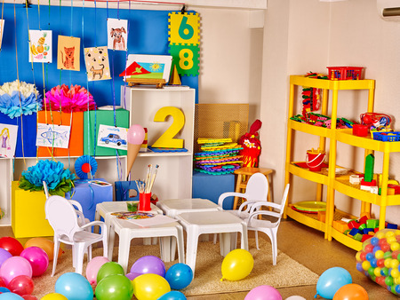 Interior of kids game room with toys in kindergarten.