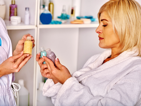35 40 years old: Portrait of middle-aged woman in spa salon with cosmetics. Stock Photo