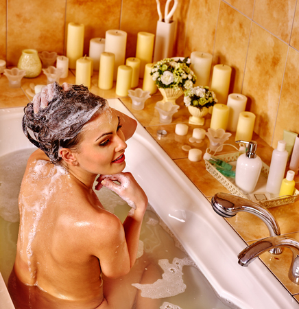 woman in bath: Woman relaxing at home luxury bath. Girl washing her hair. Stock Photo