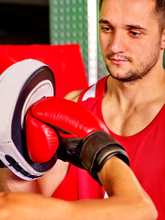circular muscle: Two  men boxer wearing red helmet boxing on ring. Stock Photo