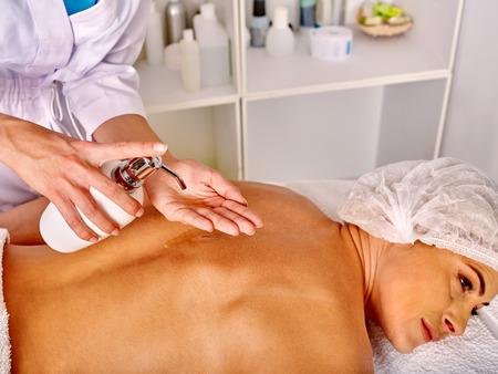 35 40 years old: Woman middle-aged take back relax massage in spa salon with beauty cosmetic. Stock Photo