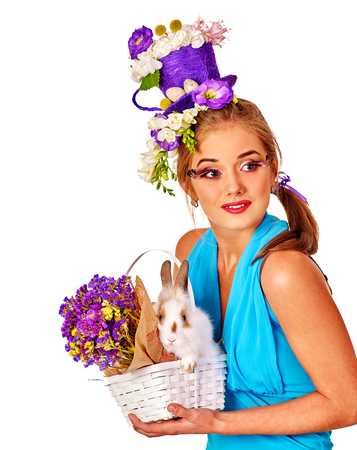 animal head: Woman in easter style holding fluffy bunny and purple flowers. Isolated.