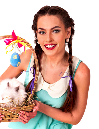 sexy funny: Woman with two braids in easter style holding eggs and rabbit in basket. Isolated.