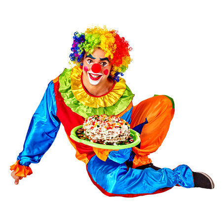 birthday clown: Happy male birthday clown holding cake.  Chidhood concept. Isolated.