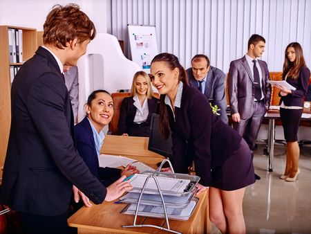 Office women: Happy group business people in office. Man speaking with women.