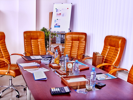 leather chair: Empty business interior with  table and leather chair in office.