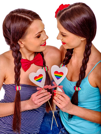 adult sex: Two lesbian women with paper heard symbol  in erotic foreplay game.