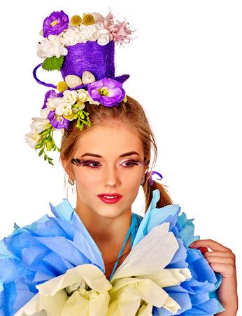false eyelashes: Portrait woman with false eyelashes in easter dress  holding  flowers. Isolated.