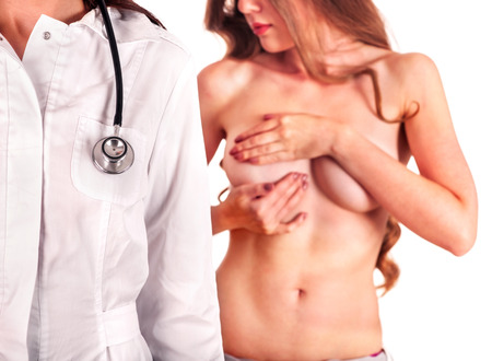 bare breast: Medical concept of doctor mammolog and young naked woman patient on isolated.