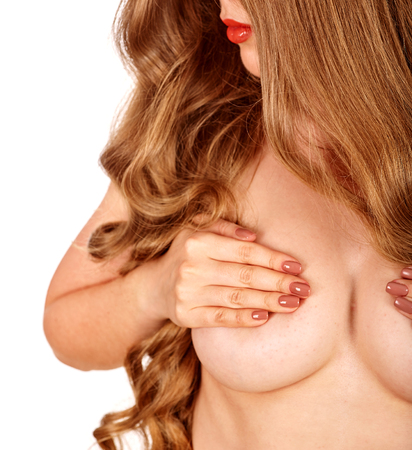 20's nude: Breast self exam. Naked girl with long beautiful hair examines her nude topless breasts. Stock Photo