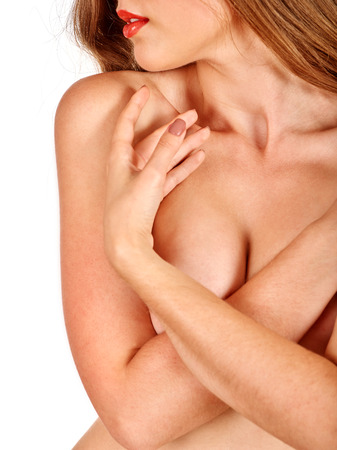 breast beauty: Portrait of a girl with beautiful nude topless breasts coverds herself.