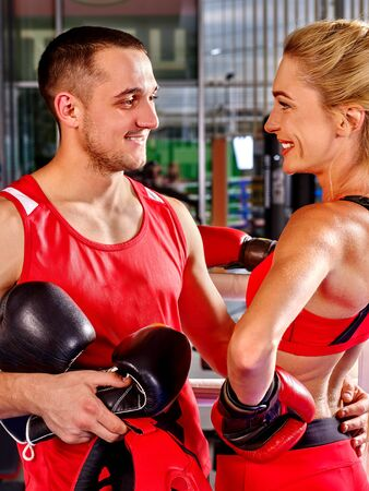health woman: Female boxer with your male coach after workout in gym. Martial arts.