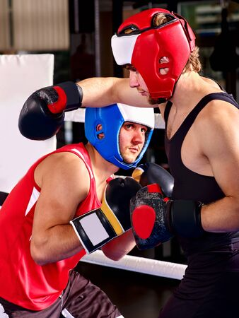 arts and entertainment: Two  men boxer wearing helmet and  gloves boxing. Martial arts.