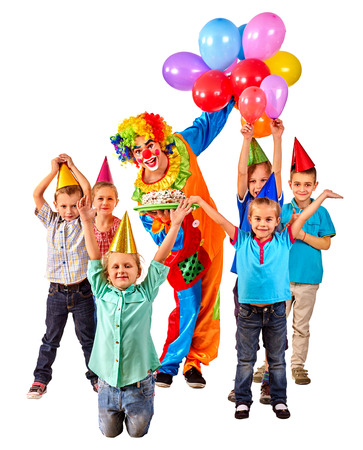 children birthday: Clown keeps bunch of balloons and birthday cake with group children. Isolated.