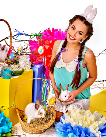 sexy funny: Woman wearing rabbit costume easter style holding eggs and group rabbits in basket. Isolated.