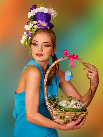 false eyelashes: Woman with false eyelashes  and flowers in stylish hairstyle keep easter bunny.