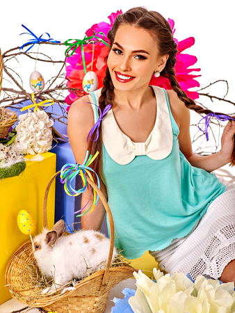 sexy glamour model: Woman in easter interior holding eggs and live  rabbit in basket. Top view.