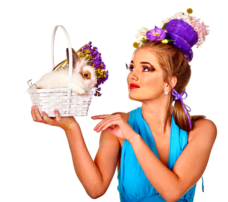 admires: Fashion woman in easter style admires to bunny and flowers. Isolated.