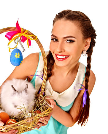 Woman in easter style keeps rabbit basket decorate eggs. Isolated.