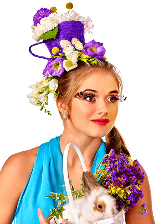 sexy glamour model: Fashion woman with false eyelashes in easter style keep bunny and flowers. Isolated. Stock Photo
