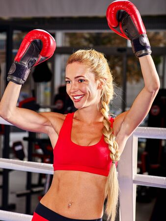 martial arts woman: Portrait of sport girl hands up boxing wearing red gloves. Stock Photo