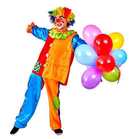 birthday clown: Happy birthday clown holding keeps bunch of balloons.  Isolated.