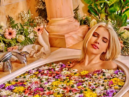 women bathing: Woman in water relaxing at luxury bath with flowers spa.