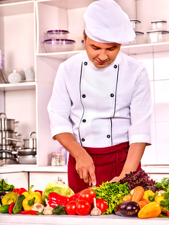 40 45 years: Happy man professional in chef hat cooking . Stock Photo