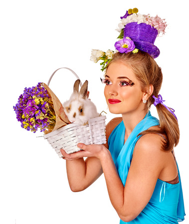 bunny girl: Fashion woman in easter style keeps white bunny and flowers. Isolated. Stock Photo