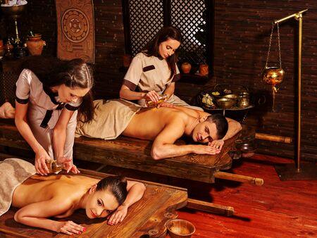window treatments: Young family having oil Ayurveda spa treatment.