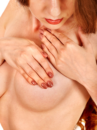 nude breast: Breast self exam. Naked girl examines her nude topless breasts. Body part. Stock Photo