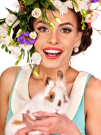 sexy fashion: Woman in easter style keeps white rabbits and flowers. Isolated. Stock Photo
