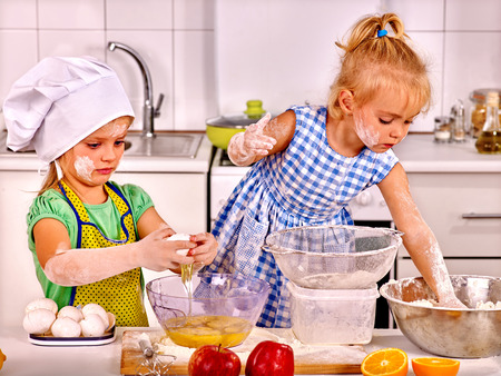 messy kids: Alone messy kids learn preparing breakfast at home kitchen