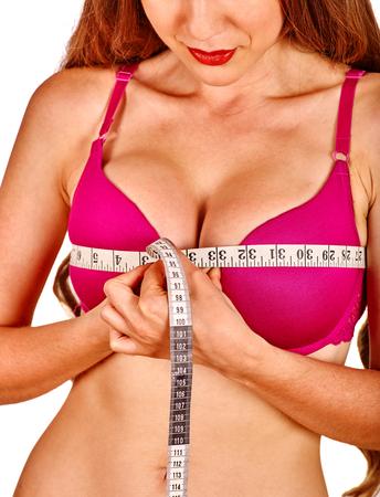 seni: Ragazza che indossa in lingerie misura il suo nastro di misurazione del seno. Parte del corpo. Archivio Fotografico