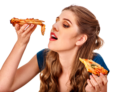Young beautiful woman eating eats with appetite big pizza. Fastfood concept. Isolated.