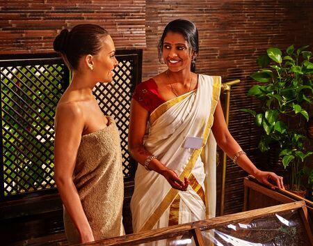 Woman before Ayurvedic India sauna treatment.