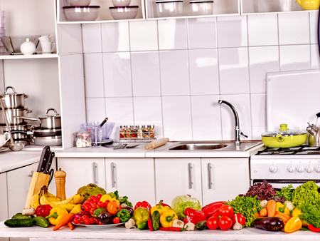 white kitchen: Interior of kitchen with fresh vegetables. Large group of vegetable.