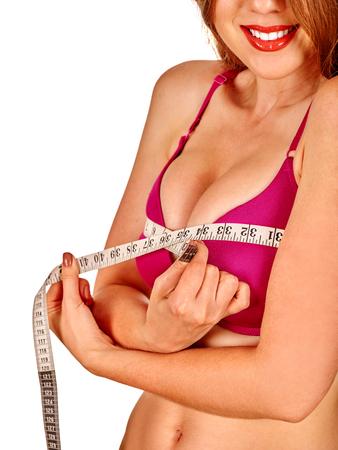 Girl wearing in lingerie measures her breast measuring tape. Health female breast.