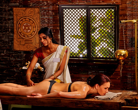panchakarma: Young woman having Ayurveda spa treatment in India salon.