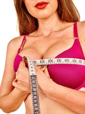 breasts erotic: Girl wearing in red lingerie measures her big breast measuring tape.