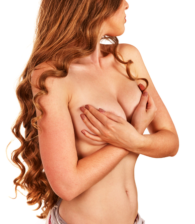 nude breast: Breast self exam. Naked girl with thin waist examines her nude topless breasts. Stock Photo