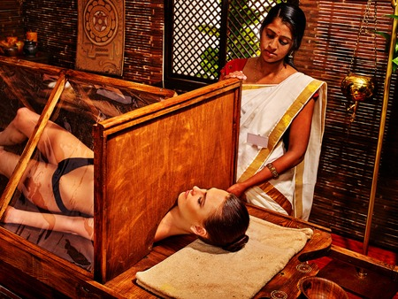 preparatory: Woman having Ayurvedic sauna treatment. She relaxed. Preparatory procedures. Stock Photo