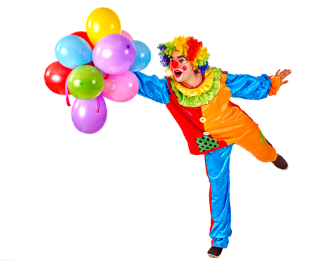 glad: Happy birthday. Glad clown holding a bunch of balloons.  Isolated. Stock Photo