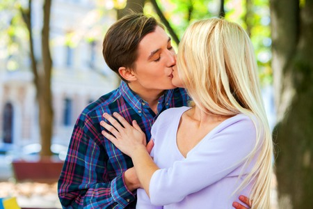 passionate lovers: Young couple kissing and hugging  in spring park . Passionate kiss of two lovers. Stock Photo