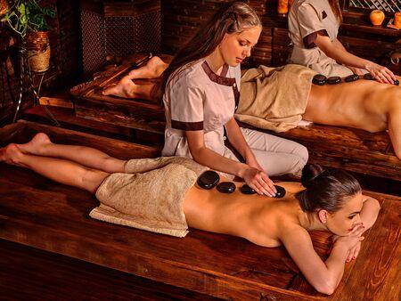 panchakarma: Couple  having stone massage. Ayurveda lastone spa treatment.