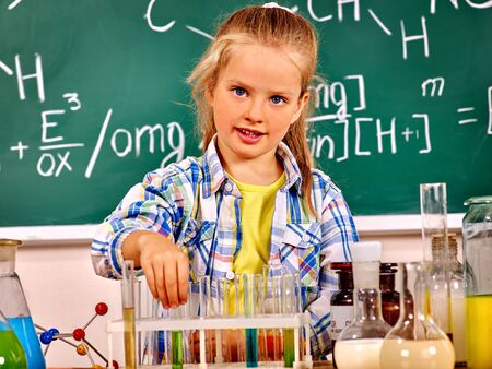 chemistry class: Child toch flask in chemistry class. Stock Photo